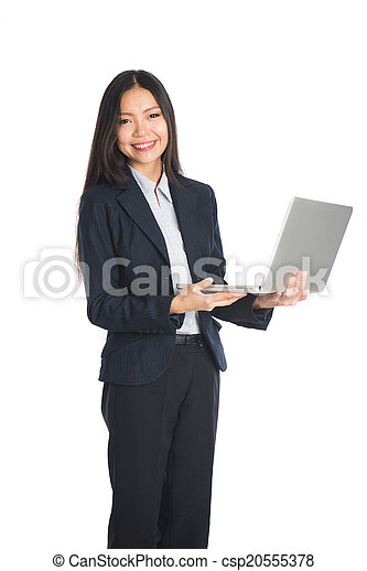 asian business woman with laptop standing with white background - csp20555378