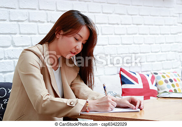 Asian business women working in the home - csp63422029