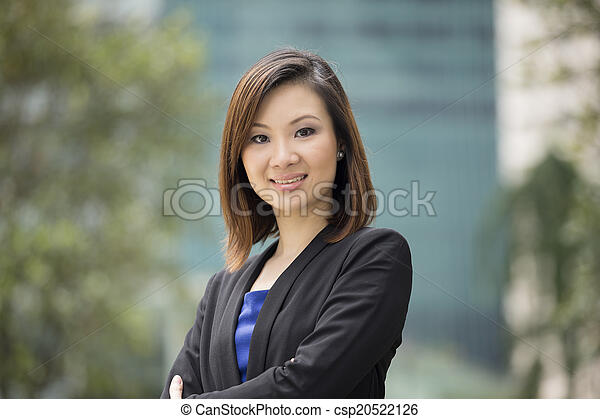 Asian businesswoman standing outside. - csp20522126