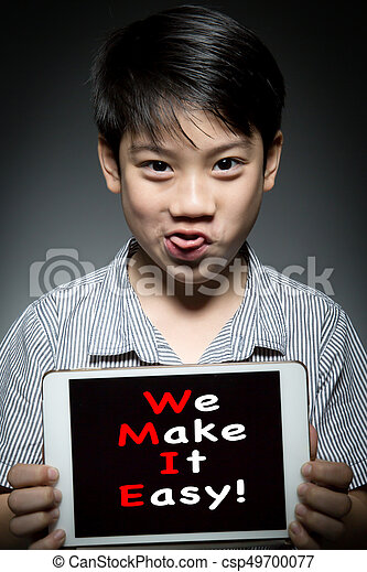 Asian child holding digital tablet ,With  WE MAKE IT EASY! - csp49700077