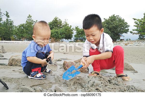 Asian children playing sand - csp56090175