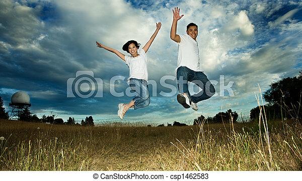 Asian couple jumping in joy - csp1462583