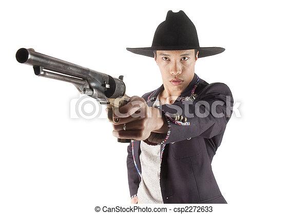 Asian cowboy. Young asian cowboy pointing gun at viewer ...