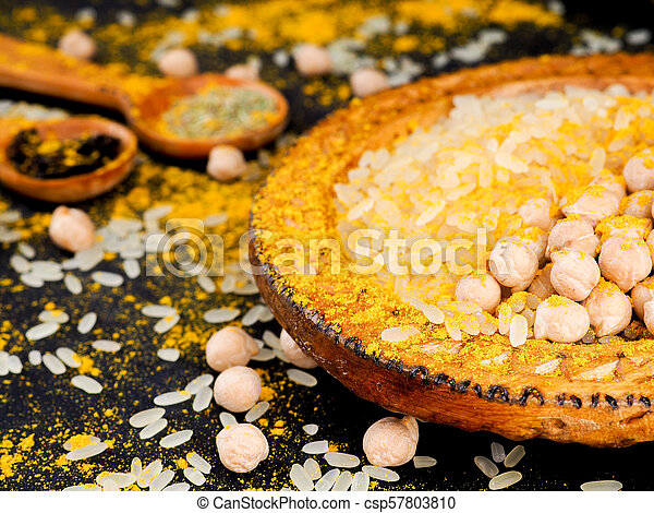 Asian cuisine, spices, rice, chickpeas and turmeric on a plate - csp57803810