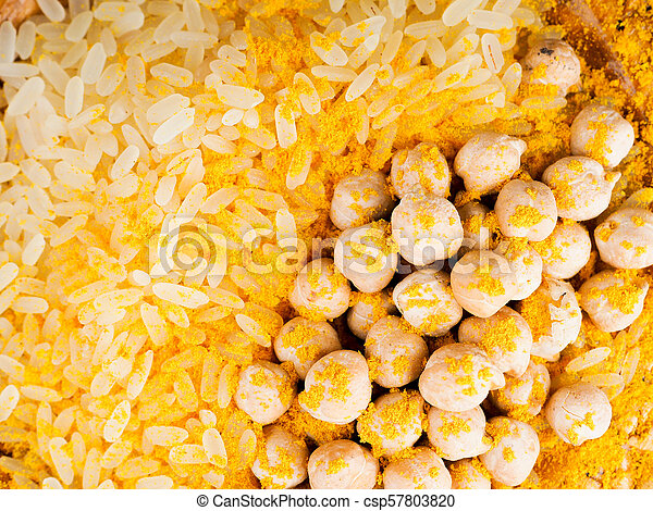 Asian cuisine, spices, rice, chickpeas and turmeric on a plate - csp57803820