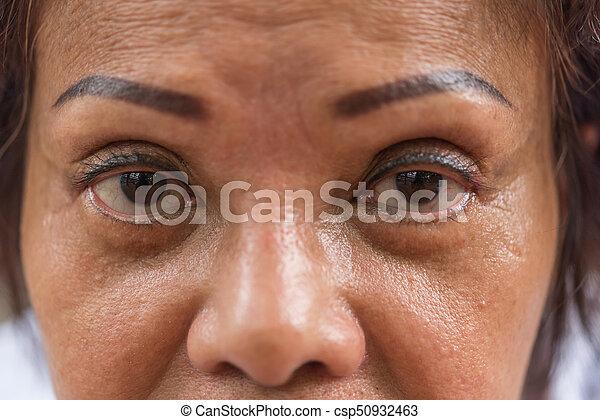 Asian elder women show her eyes and eyebrow tattoo. Asian elder ...