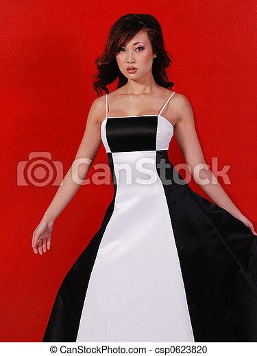 bcb5e1093224 asian formal fashion. Beautiful asian woman wearing a formal dress.