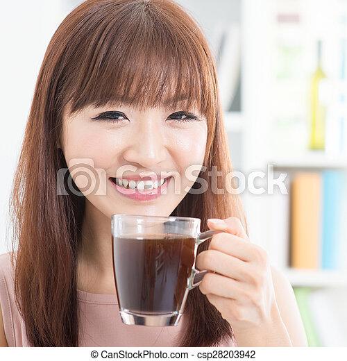 Asian girl enjoying coffee - csp28203942
