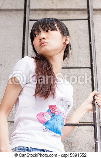 Asian girl on ladder