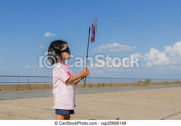 Asian girl with wind turbine in hands - csp25666149