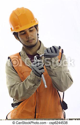 asian latino hard hat worker  - csp6244538