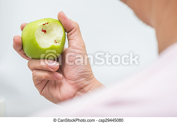 Asian man bite green apple and scurvy - csp29445080