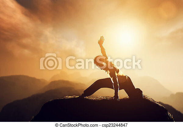 Asian man, fighter practices martial arts in high mountains at sunset. - csp23244847