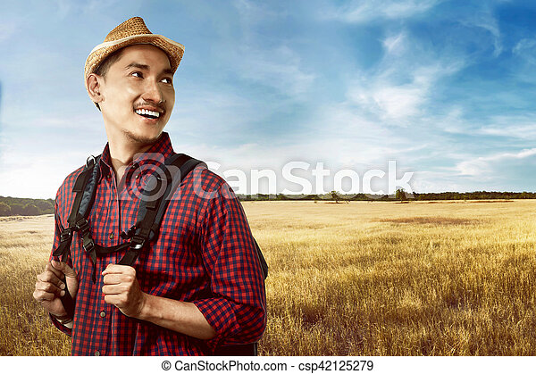 32a49ae3a8d74 Asian man wearing hat travel alone. Image of handsome asian man ...