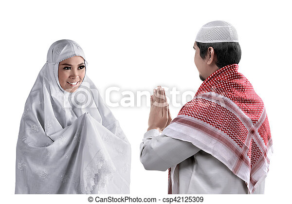 Asian muslim man and woman greet each other with muslim tradition asian muslim man and woman csp42125309 m4hsunfo