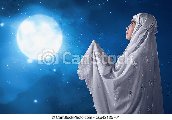 Asian muslim woman pray to god - csp42125701