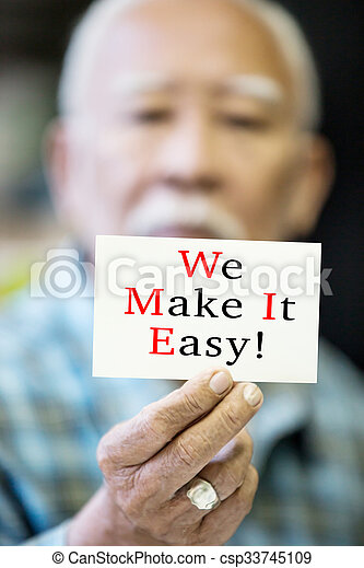 Asian Old man with WE MAKE IT EASY! message on hand - csp33745109