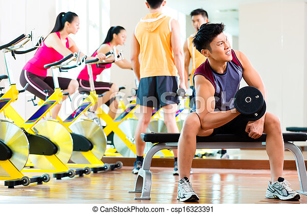 Asian people exercising sport for fitness in gym - csp16323391