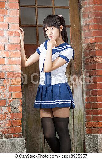 Asian Schoolgirl In Uniform Outside School Csp18935357