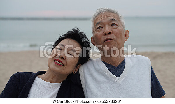 Asian senior couple enjoy their life time together at the sea - csp53733261