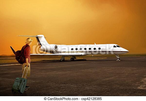 Asian traveler man walking to the plane. travel concept