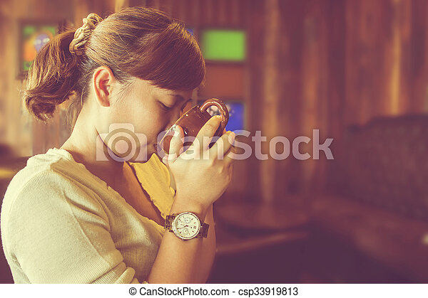 Asian woman drinking coffee. (Vintage process) - csp33919813