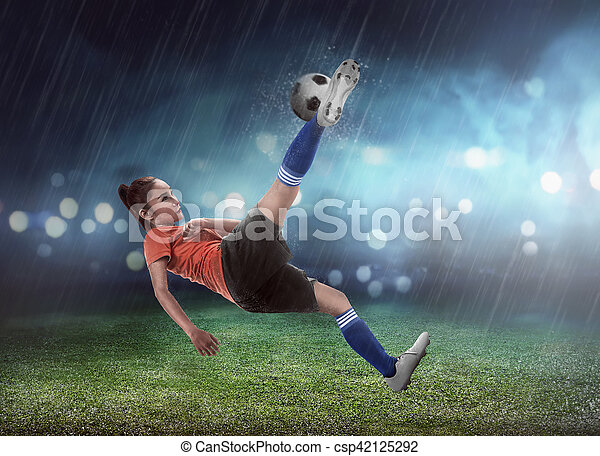 Asian woman football player kick ball - csp42125292
