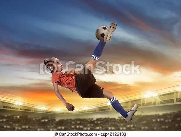 Asian woman football player kick ball - csp42126103