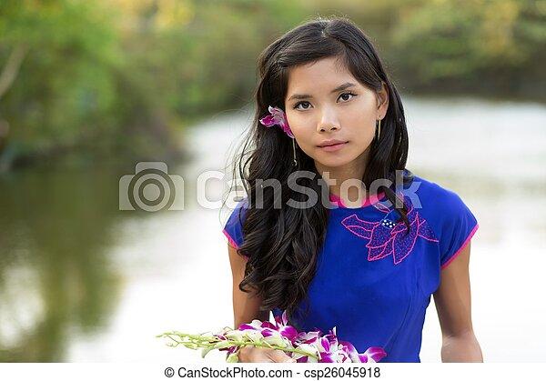 Asian woman holding fresh flowers - csp26045918