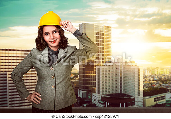 asian woman holding hard hat asian woman engineer holding yellow