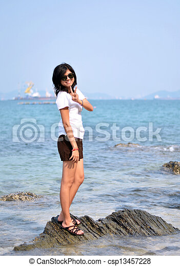 Asian woman on beach summer holiday - csp13457228