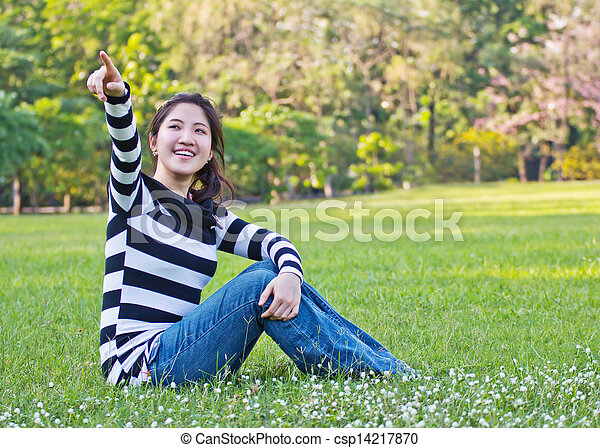 Asian woman pointing the tree - csp14217870
