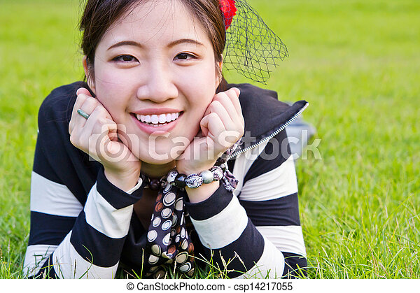 Asian woman relaxing on the grass  - csp14217055