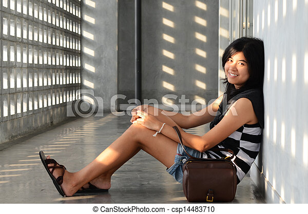 Asian woman sitting on corridor floor - csp14483710