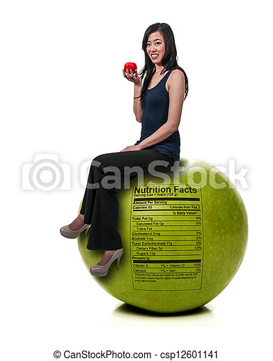 Asian Woman Sitting on Red Delicious Apple with Nutrition Label - csp12601141
