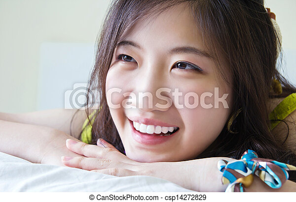 Asian woman smiling on the bed  - csp14272829