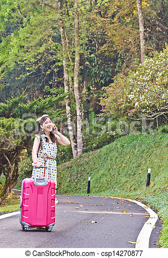 Asian woman talking on the phone - csp14270877