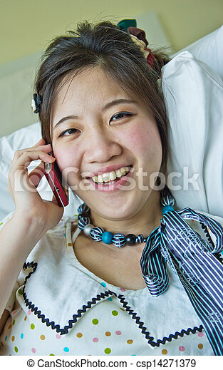 Asian woman talking on the phone  - csp14271379