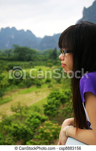 Asian woman thinking outdoor - csp8883156