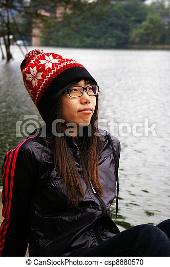 Asian woman thinking - csp8880570