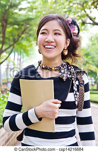 Asian woman walking in the park - csp14216684