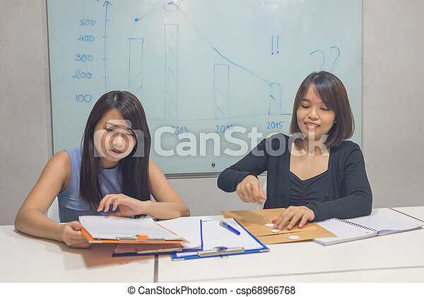 Asian women working in the meeting room - csp68966768