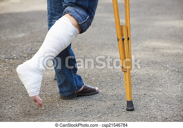 asian Young man on crutches with tree background - csp21546784