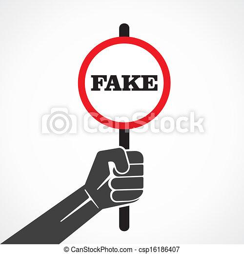 Palabra falsa aplacada sostenida en la mano - csp16186407