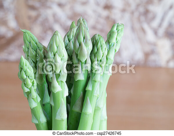 asparagus on wooden table - csp27426745