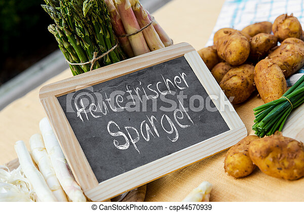 Asparagus with blackboard and german words - csp44570939