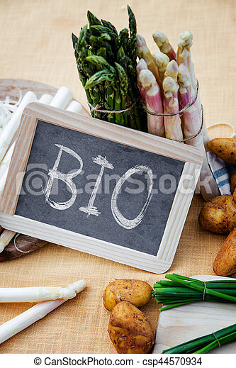 Asparagus with blackboard the word bio - csp44570934