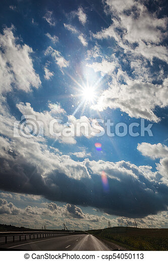 Asphalt road in a sunny summer day - csp54050113