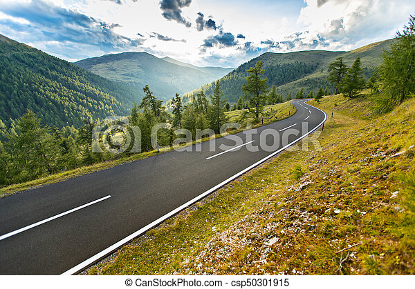 Asphalt road in Austria, Alps in a summer day. - csp50301915