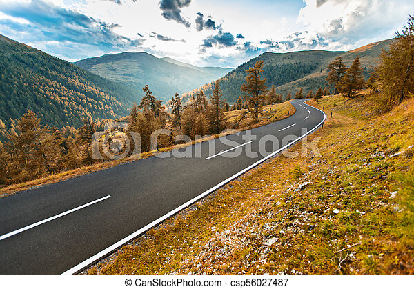 Asphalt road in Austria, Alps in a summer day. - csp56027487
